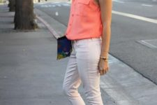 With peach colored sleeveless shirt, clutch and white cropped pants