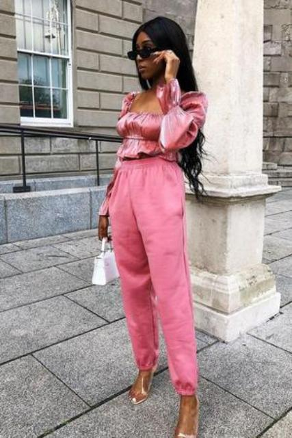 With pink jogger pants, white mini bag and transparent shoes