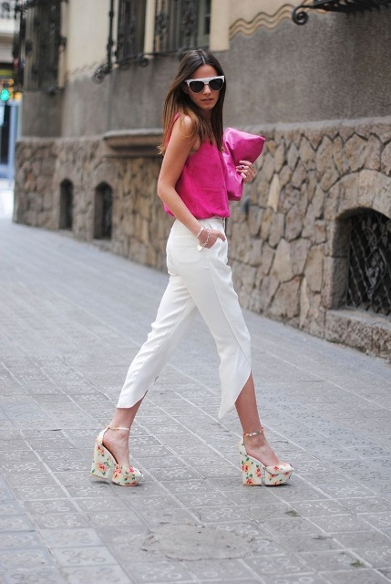 With pink top, pink clutch and white asymmetrical trousers