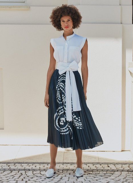 With pleated midi skirt and flat mules