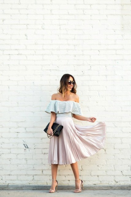 With pleated midi skirt, black leather bag and ankle strap high heels