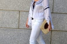 With printed blouse, white pants and black pumps