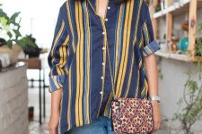 With printed chain strap crossbody bag and distressed loose jeans