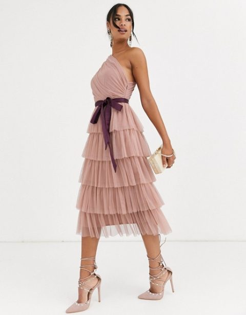 With purple belt, beige clutch and pale pink lace up high heels