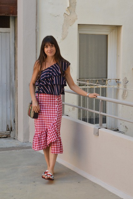 With red and white checked wrap midi skirt, printed bag and flat sandals