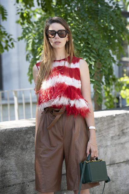 With red and white fringe top and emerald green bag