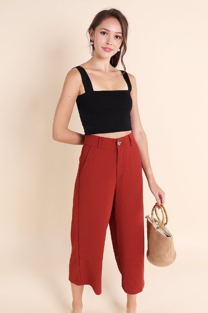With red culottes and beige bag