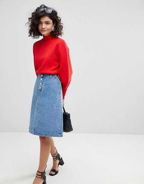 With red sweatshirt, black bag and black lace up low heeled sandals