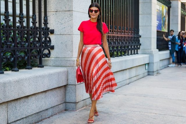 With red t-shirt, red bag and red lace up sandals