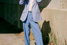 With ruffled blouse, lilac blazer and black low heeled shoes
