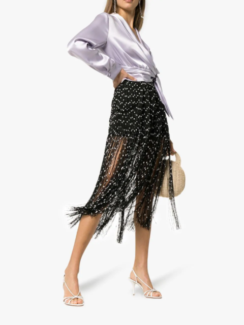 With satin wrap blouse, straw bag and white heeled sandals