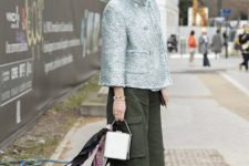 With silver jacket, white mini bag and olive green culottes