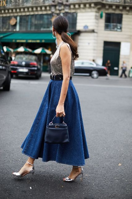 With silver sleeveless top, black belt, navy blue leather mini bag and silver ankle strap high heels