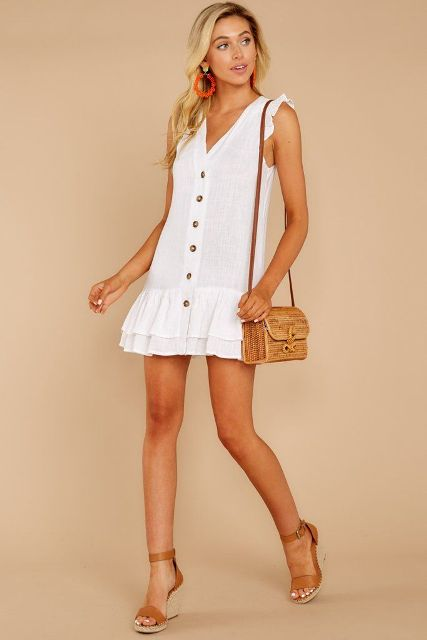 With straw bag and brown ankle strap platform sandals