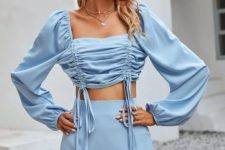 With straw hat and light blue mini skirt
