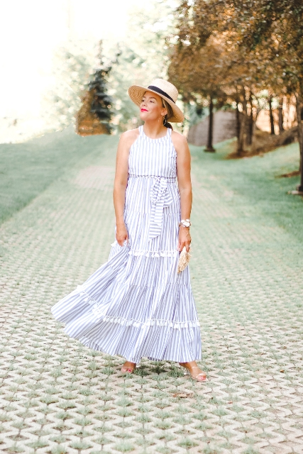 With straw wide brim hat, clutch and high heels
