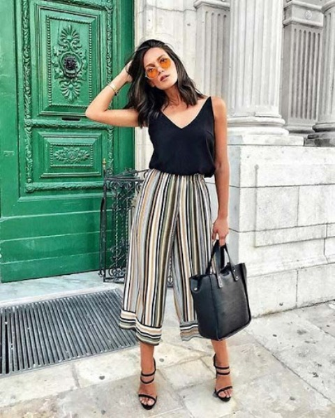 With striped culottes, black leather tote bag and black high heels