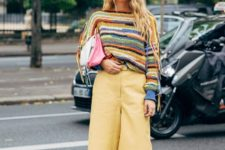 With striped sweatshirt, two colored clutch and pumps