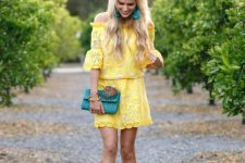 With turquoise clutch, earrings and beige sandals