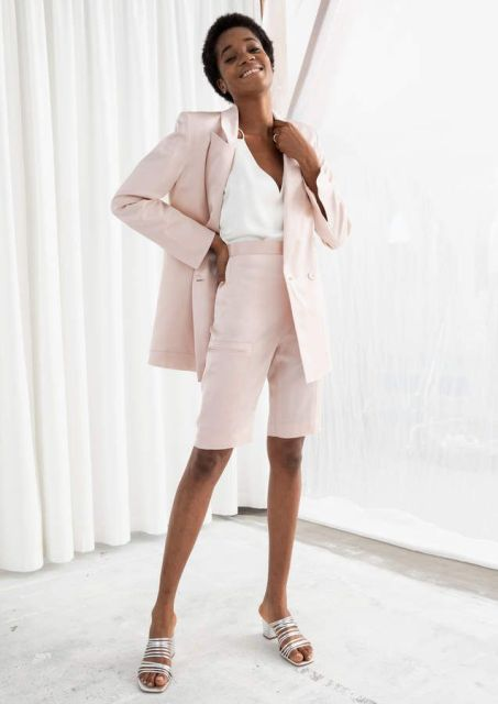 With white V neck top, pale pink blazer and silver mules