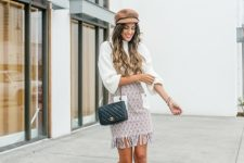 With white blouse, beige cap, chain strap bag and white ankle boots