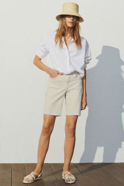 With white button down shirt, beige hat and white flat sandals