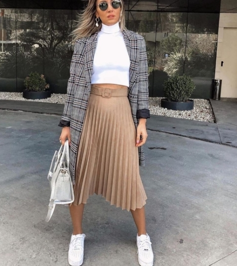 With white crop turtleneck, checked trench coat, white bag and white sneakers