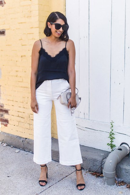 With white culottes, gray bag and black ankle strap shoes