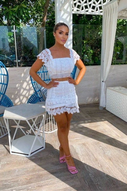 With white lace mini skirt and pink lace up sandals