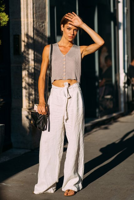 With white linen belted palazzo pants, sandals and black bag