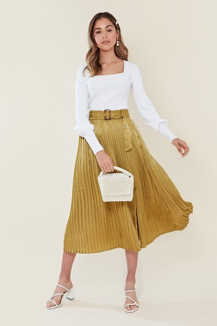 With white long sleeved shirt, beige bag and white lace up sandals