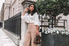 With white loose blouse, printed bag and sandals