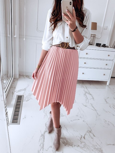 With white loose shirt and gray ankle boots