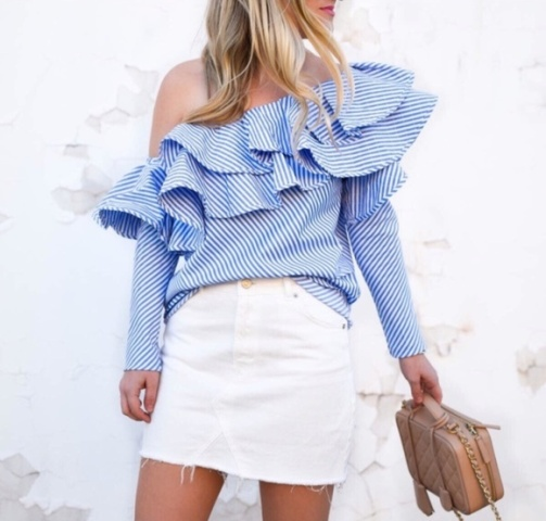 With white mini skirt and beige leather bag