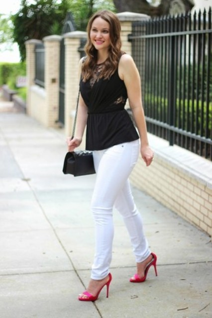 With white pants, black chain strap bag and pink high heels