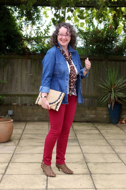 With white shirt, red trousers, denim jacket, leopard printed scarf and leopard printed low heeled boots