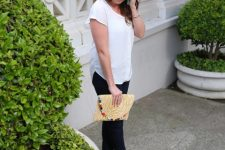 With white shirt, skinny trousers and beige sandals