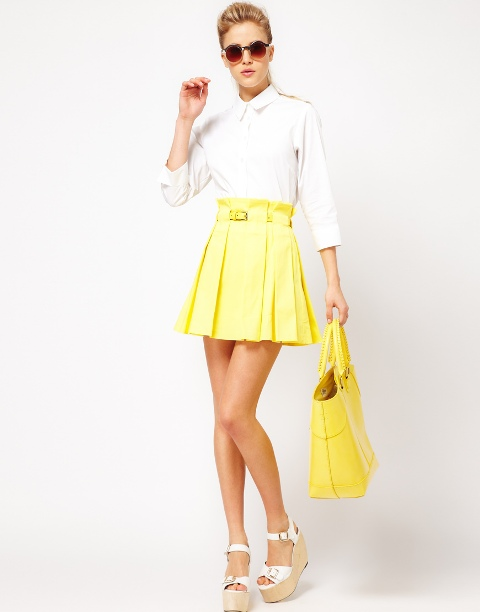 With white shirt, yellow tote bag and platform sandals