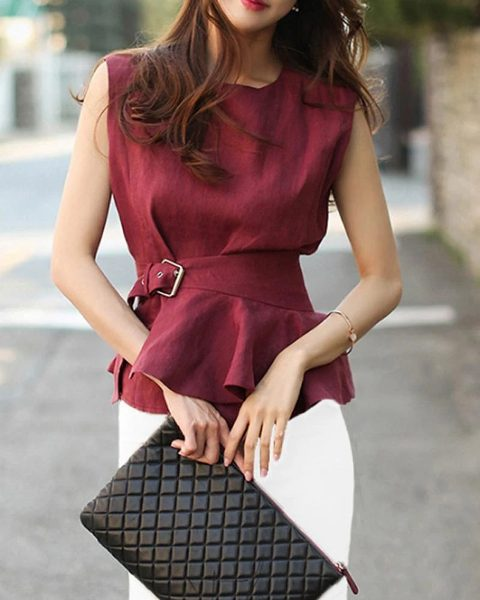 With white skinny pants and black leather clutch