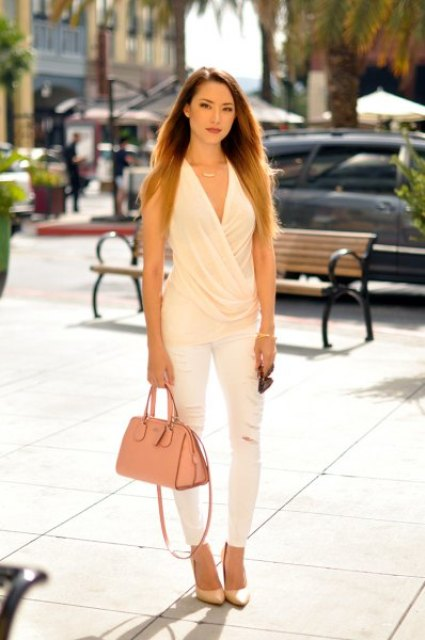 With white skinny pants, pale pink bag and beige pumps