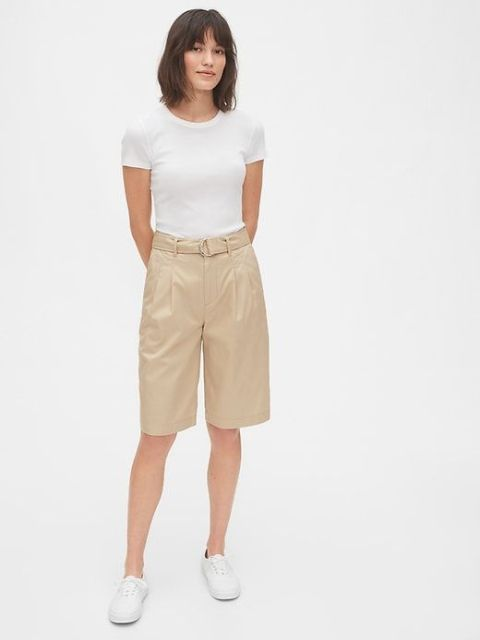 With white t-shirt and white flat shoes