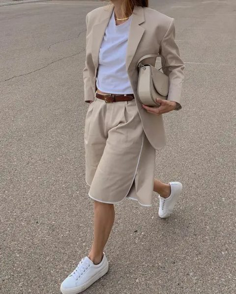 With white t-shirt, beige long blazer, white sneakers and beige leather bag