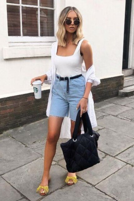 With white top, white shirt, black tote bag and yellow fringe flat sandals