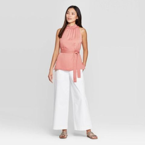 With white trousers and flat sandals