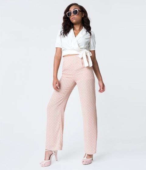 With white wrap crop blouse and pale pink high heels