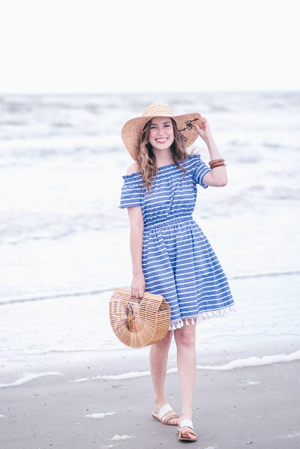 With wide brim hat, straw bag and white and beige flat sandals