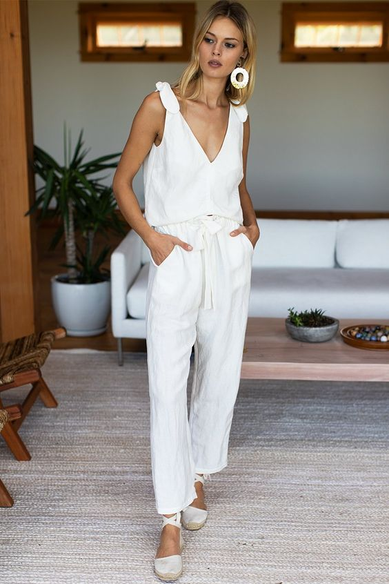 a beautiful linen set with a tied strap top and pants, white espadrilles, statement earrings for summer