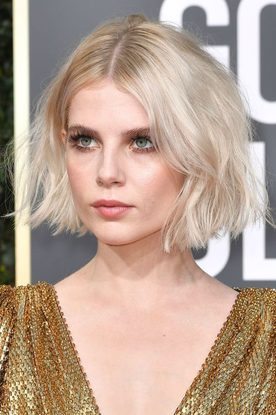 a beautiful short blonde bob with much volume and slight waves is a very chic and stylish idea