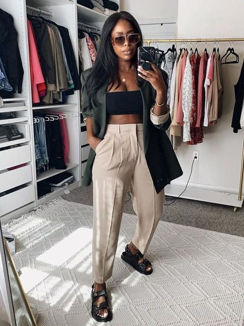 a black crop top, neutral linen trousers, a dark green oversized blazer, black dad sandals are a great and trendy look for summer