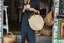 a black linen midi shirtdress, white sneakers, a round straw bag for a hot summer day